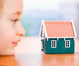 Child looking at house