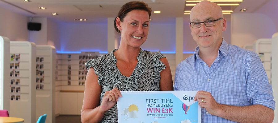 First time buyers' prize draw winner with Bruce Spence, Head of Compliance at ESPC